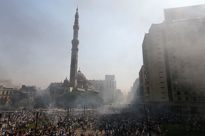 Smoke rises near Al-Fateh Mosque during clashes at Ramses Square in Cairo