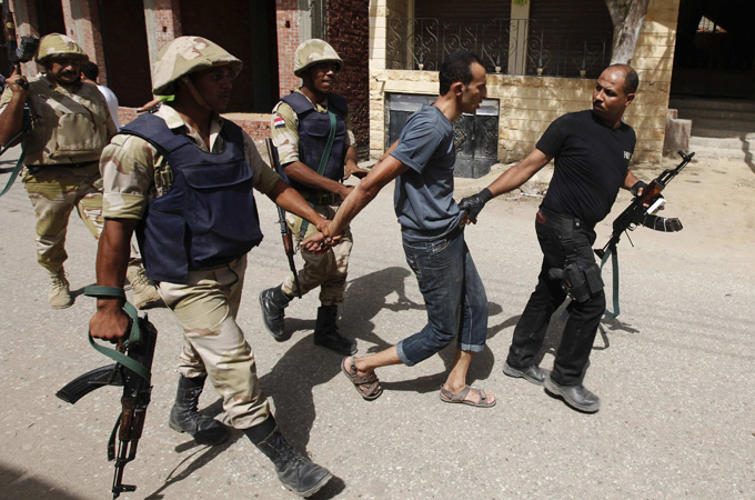 Security forces arrest a suspect in Kerdasah on the outskirts of Cairo