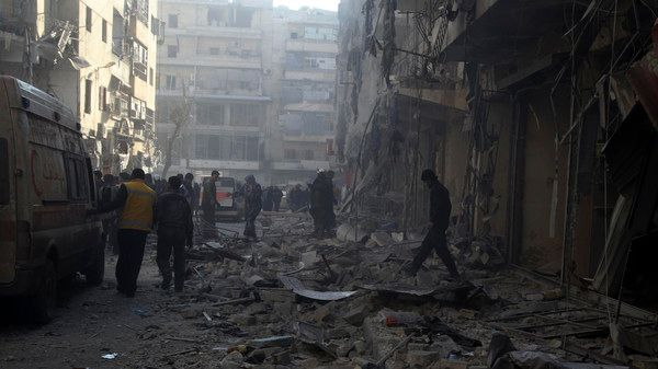 People inspect a damaged site after what activists said was an air raid by forces loyal to Syrian President Bashar Al-Assad, in Aleppo's district of Al Sukari
