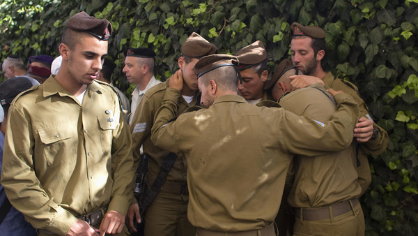 Israeli soldiers mourn during the funeral of their comrade Moshe Malko at the Mount Herzl military cemetery in Jerusalem