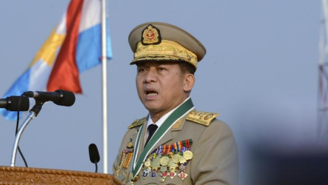 Myanmar's Commander-in-chief Senior Gen.  Min Aung Hlaing speaks during a ceremony to mark the 70th anniversary of Armed Forces Day in Naypyitaw, Myanmar, Friday, March 27, 2015. Myanmar's powerful army commander has pledged to work to support successful elections in November and warned that the army will not tolerate instability or armed threats. (AP Photo/Khin Maung Win)