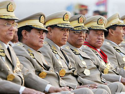 **FILE**Myanmar's military leaders look on Tuesday, March 27, 2007, as they wait for the arrival of Myanmar's military junta leader Gen. Than Shwe just prior to Armed Forces Day ceremonies in the new capital city of Naypyidaw, Myanmar. Daily demonstrations by tens of thousands of people have grown into the stiffest challenge to the ruling junta in two decades. (AP Photo/David Longstreath, FILE)