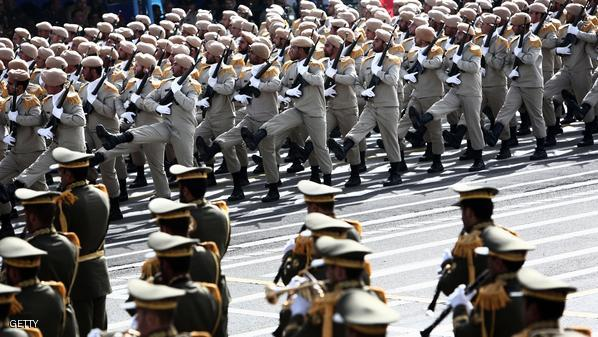 Iranian Army soldiers march during the Army Day parade in Tehran on April 18, 2015. Amid rising tension between Iran and Saudi Arabia, Iranian President Hassan Rouhani said that Iran's military is purely for defence and should not be seen as an aggressive threat in the Middle East. AFP PHOTO/BEHROUZ MEHRI        (Photo credit should read BEHROUZ MEHRI/AFP/Getty Images)