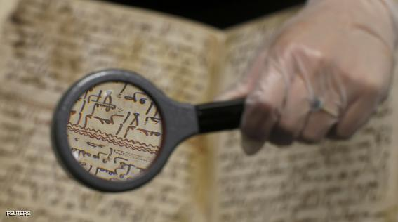 A detail of a fragment of a Koran manuscript is seen through a magnifying glass in the library at the University of Birmingham in Britain July 22, 2015. A British university said on Wednesday that fragments of a Koran manuscript found in its library were from one of the oldest surviving copies of the Islamic text in the world, possibly written by someone who might have known Prophet Mohammad. Radiocarbon dating indicated that the parchment folios held by the University of Birmingham in central England were at least 1,370 years old, which would make them one of the earliest written forms of the Islamic holy book in existence. REUTERS/Peter Nicholls
