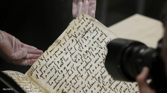 A fragment of a Koran manuscript is photographed in the library at the University of Birmingham in Britain July 22, 2015. A British university said on Wednesday that fragments of a Koran manuscript found in its library were from one of the oldest surviving copies of the Islamic text in the world, possibly written by someone who might have known Prophet Mohammad. Radiocarbon dating indicated that the parchment folios held by the University of Birmingham in central England were at least 1,370 years old, which would make them one of the earliest written forms of the Islamic holy book in existence. REUTERS/Peter Nicholls