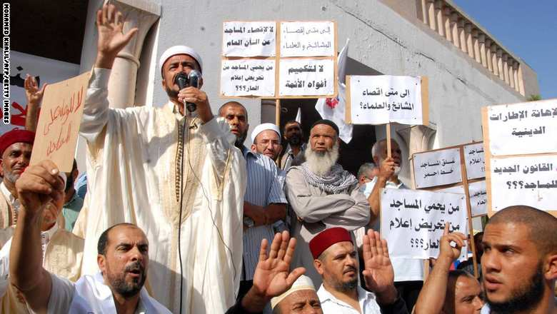 Tunisian demonstraters shout slogans during a protest against the Minister of Religious Affairs, Othman Battikh, outside the ministry's headquarters in the capital Tunis on October 21, 2015. About 250 people demonstrated outside the offices of ministry of religious affairs demanding canceling of the decision to fire imam Ridah al-Jawadi, who is allied to the Islamic Nahda party. AFP PHOTO / MOHAMED KHALIL (Photo credit should read MOHAMED KHALIL/AFP/Getty Images)