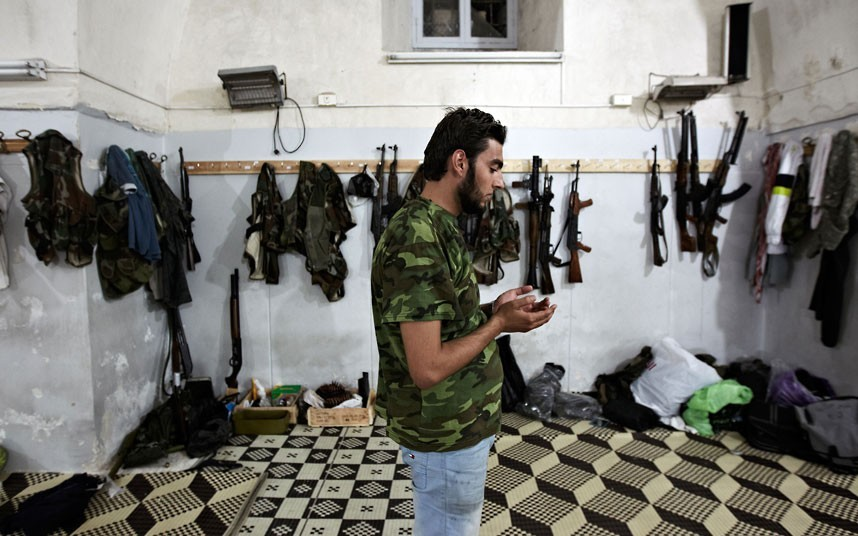 Free Syrian Army battle for Aleppo, Syria - 01 Nov 2012...Mandatory Credit: Photo by Tomada/Sipa USA / Rex Features (1944520j) Ahmed Bab, a twenty-three-year-old FSA fighter prays in a mosque in between clashes Free Syrian Army battle for Aleppo, Syria - 01 Nov 2012