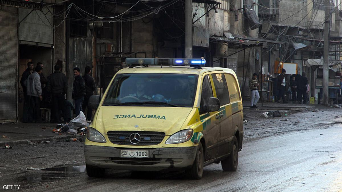 An ambulance drives through a street of the northern Syrian city of Aleppo on January 24, 2014. The Syrian government warned it may quit peace talks in Geneva, accusing the opposition of being neither serious nor prepared for negotiations, state television said. AFP PHOTO / MOHAMMED WESAM (Photo credit should read MOHAMMED WESAM/AFP/Getty Images)